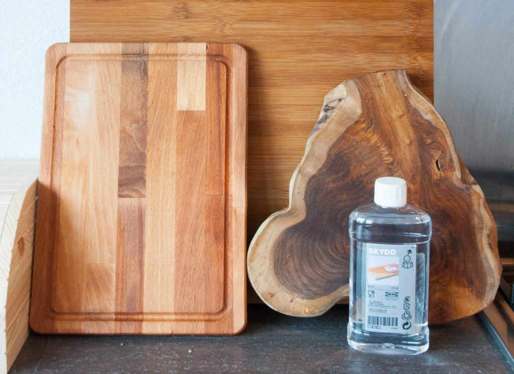A photo of cutting boards and a bottle of wood oil. First Kitchen Essentials for Your New Apartment