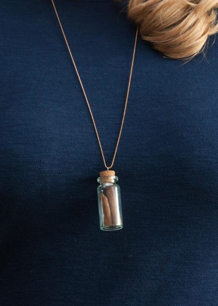 How to Make Apothecary Spice Jar Necklaces for Fall. A necklace with a small spice jar on it.