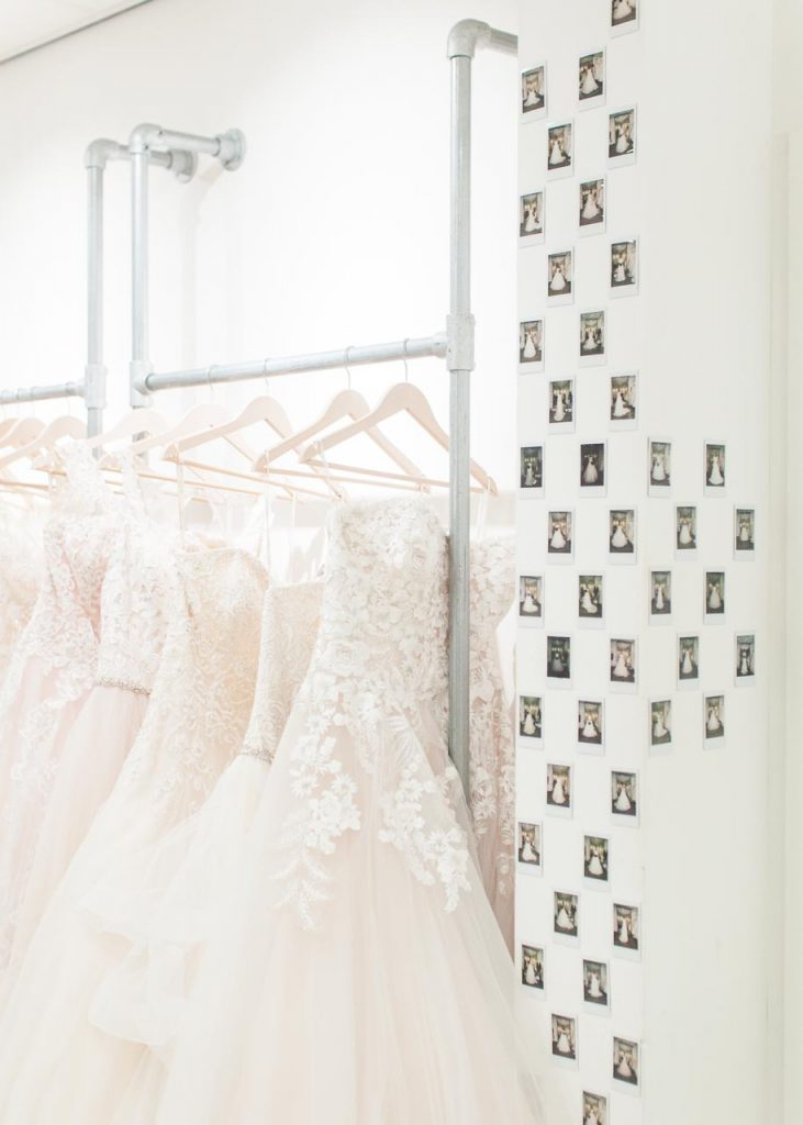 A picture of wedding dresses in the Lovely Weddings shop. Lovely Weddings — Sara Laughed