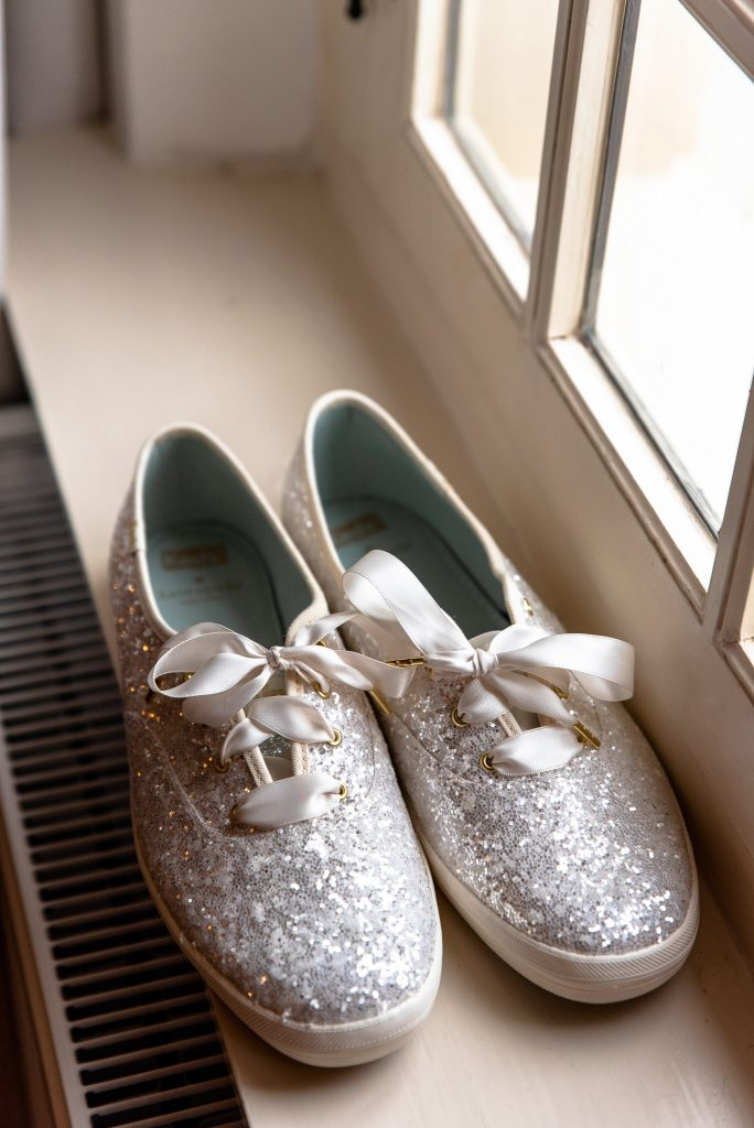 My wedding shoes, glittery sneakers by Kate Spade.