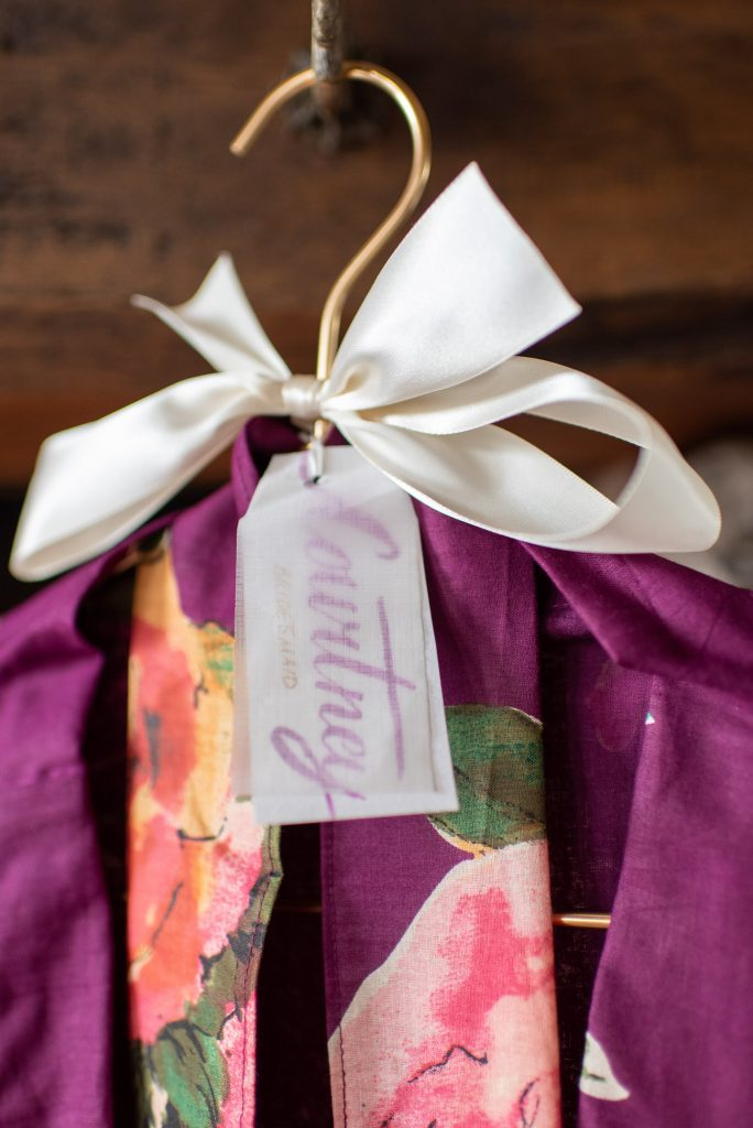 One of the bridesmaids robes, with a nametag that I hand-lettered
