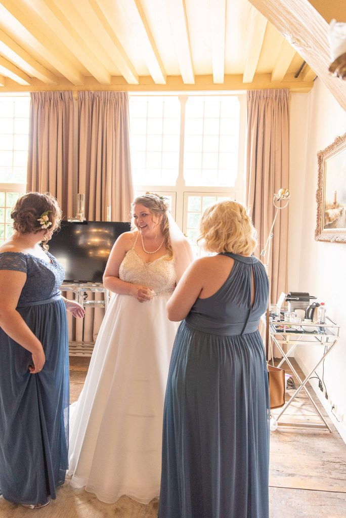 Standing with two bridesmaids.