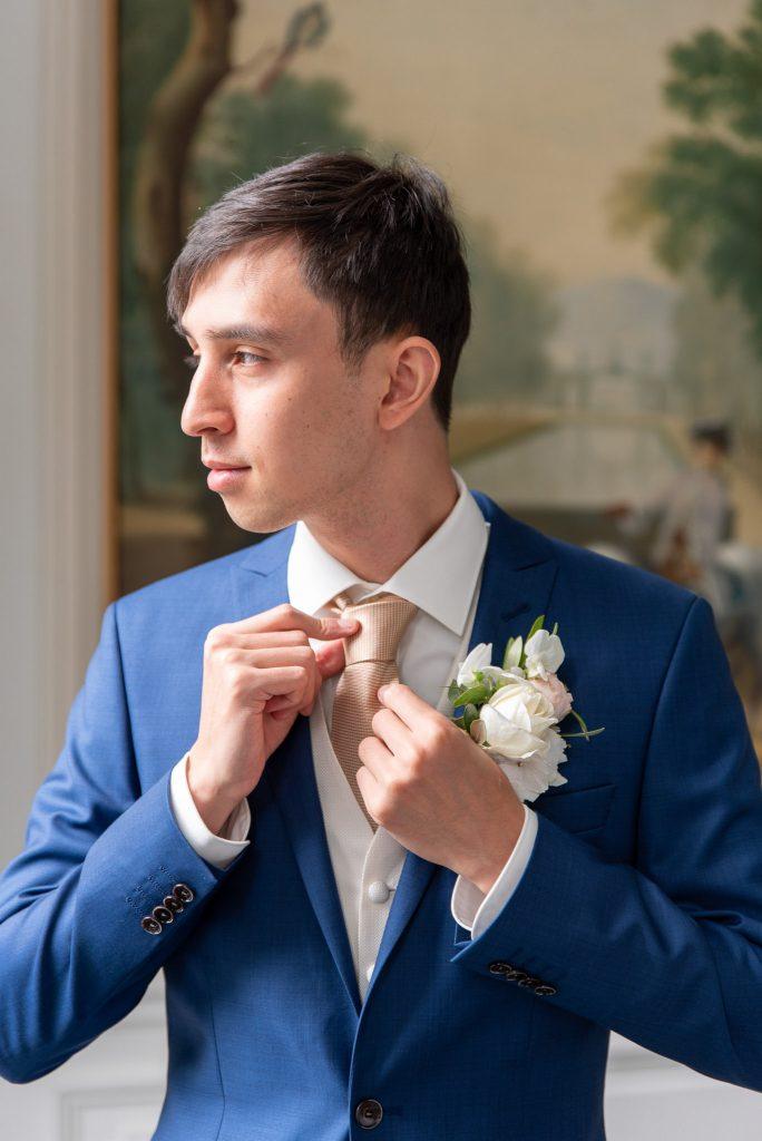 Ken straightening his tie before the first look