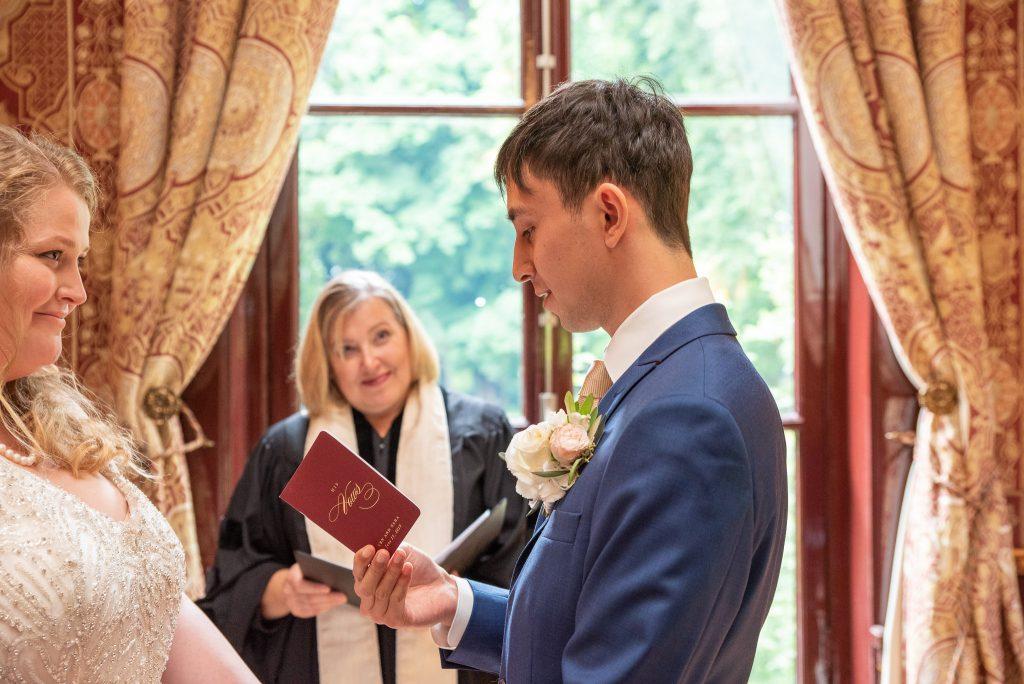Ken reading his vows