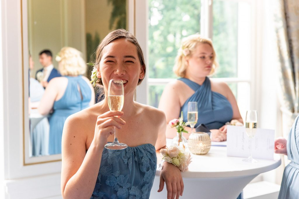 A bridesmaid with champagne